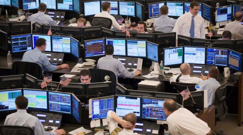 Equity traders with Knight Capital Group follow stock prices on computer screen following the open of trading on Wednesday, Jan. 20, 2008 in Jersey City, N.J. The Federal Reserve is likely to follow its bold action last week to battle an economic downturn with further interest rate reductions, although analysts are split on just what size the future cuts will be. (AP Photo/Mark Lennihan)